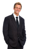 Handsome man in business suit. Happy smiling corporate person in black business suit, isolated on white Royalty Free Stock Photography