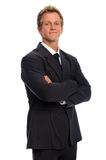 Handsome man in business suit. Happy smiling corporate person in black business suit, isolated on white Stock Images