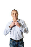 Handsome man buttoning his shirt Royalty Free Stock Photography