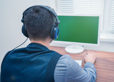 Handsome man in call center with headphones Stock Photo