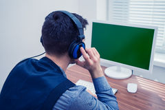 Handsome man in call center with headphones Royalty Free Stock Photography