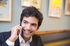 Handsome man calling with a cell phone in coffee bar Stock Photo