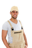 Handsome man in cap and dungarees Royalty Free Stock Image