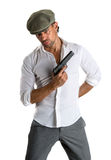 Handsome man in cap with a gun. On a white background Stock Image