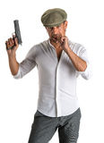 Handsome man in cap with a gun. On a white background Royalty Free Stock Photo