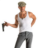 Handsome man in cap with a gun. On a white background Stock Images