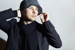 Handsome Man in Cap. Stylish Boy in scarf.Young man.spring casual fashion Royalty Free Stock Images