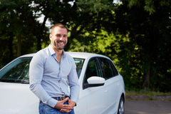 Handsome man with car Royalty Free Stock Photography