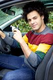 Handsome man in car holding key looking camera Royalty Free Stock Photos