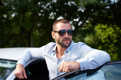 Handsome man with car Stock Image