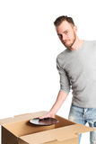 Handsome man with cardboard box and plates Stock Photo