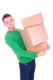 Handsome man carrying boxes Royalty Free Stock Photography