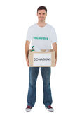 Handsome man carrying donation box with bottles Stock Photography