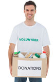 Handsome man carrying donation box with food Royalty Free Stock Photos