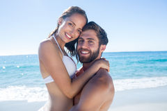 Handsome man carrying his girlfriend Royalty Free Stock Images