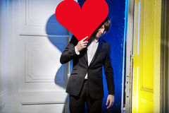 Handsome man carrying a large heart Stock Photography