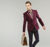 Handsome man carrying the leather handbag Royalty Free Stock Photo
