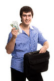Handsome man with case holding dollars Royalty Free Stock Photography