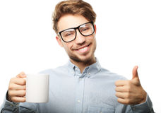 Handsome   man in casual clothes  holding a cup Stock Image