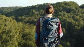 Handsome man traveling with bag, hiking in nature. Handsome man in casual clothes traveling with colorful bag, hiking in nature on weekend stock video footage