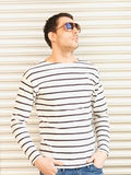 Handsome man in casual clothes  wearing sunglasses Stock Photography
