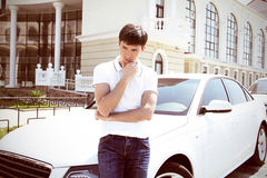 Handsome man casually leaning against the car Royalty Free Stock Photography