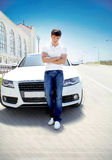 Handsome man casually leaning against the car Royalty Free Stock Image