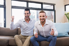Handsome man celebrating victory Royalty Free Stock Image