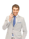 Handsome man with cell phone Stock Images