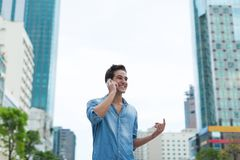 Handsome man cell phone call smile outdoor city. Street, Young attractive businessman casual blue shirt talking Stock Image