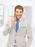 Handsome man with cell phone Royalty Free Stock Images