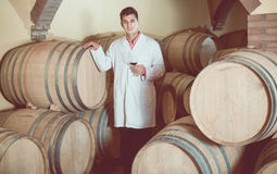 Handsome man checking ageing process of red wine Stock Photo