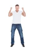 Handsome man cheering in exultation Stock Photos