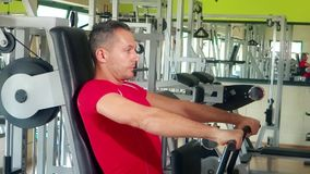 Handsome man at chest exercises stock footage