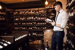 Handsome man choosing best international Austrian wine stock photos