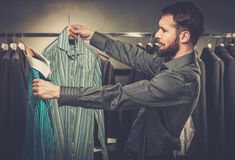 Handsome man choosing shirt Royalty Free Stock Photos