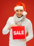 Handsome man in christmas hat Royalty Free Stock Photos