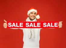 Handsome man in christmas hat Stock Photos