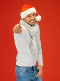 Handsome man in christmas hat Stock Images