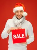 Handsome man in christmas hat Stock Photography