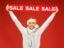 Handsome man in christmas hat Royalty Free Stock Images