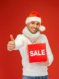 Handsome man in christmas hat Royalty Free Stock Image