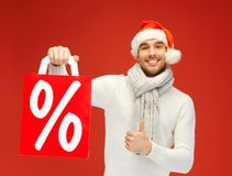 Handsome man in christmas hat Stock Image