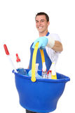 Handsome Man Cleaner. A handsome young man with cleaning supplies stock image