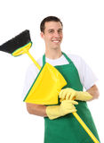 Handsome Man Cleaner. A handsome young man with cleaning broom and dustpan royalty free stock photo