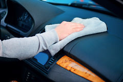Handsome man cleaning his car Royalty Free Stock Photos
