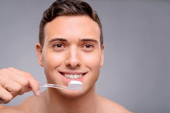 Handsome man cleaning teeth Stock Photo