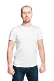 Handsome man with clenched fists in white t-shirt isolated on white stock photos