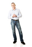 Handsome man with clenched hands Royalty Free Stock Photography