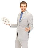 Handsome man with clock Stock Photo
